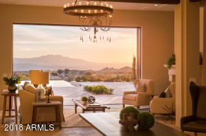 The beauty of the living room is enhanced greatly with the sunrise over the mountains.