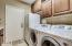 Washer and dryer convey! Laundry has cabinets, sink and plenty of space for full size freezer.