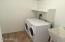 Washer and dryer in very large laundry room with a sink!