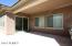 Covered patio with entrance to breakfast nook & kitchen area.