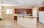 LARGE EAT IN KITCHEN WITH ISLAND, PANTRY AND LOTS OF CABINETS