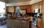 Beautiful Kitchen, Granite Counter, Lots of Cabinets, Breakfast Area & Seating at Bar on Island.