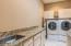 Laundry room features ample space for washing, drying and folding