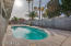 Backyard offers an extended length covered patio with fans, sparkling blue gated pool, RV Gate, and room for that built in BBQ you've always wanted.