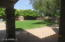 Large grass area is only part of this large developed backyard.