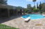 Diving Pool with numerous, large paver seating areas and Long Covered Patio.