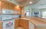 Nice open kitchen with breakfast bar, room for two stools.