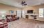 Spacious family room with gas fireplace. Includes wall-mounted flat screen TV.