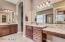 His and hers vanities with generous cabinets and granite counter tops