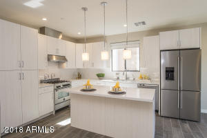 Distinctive custom cabinets w/wood interiors and soft close