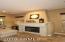 MANTELED GAS FIREPLACE WARMS THE FAMILY ROOM