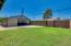 Block wall, large grass area in yard.