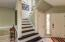 STRIKING STAIRS WITH STAIN GLASS WINDOW