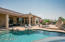 Pool View to Covered Patios and Gas Fireplace and Raised Seating Area