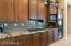 Stylish Backsplash, Granite Counter and Gas Cootop