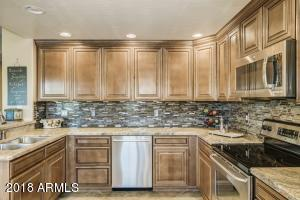 Updated cabinets, counter and backsplash