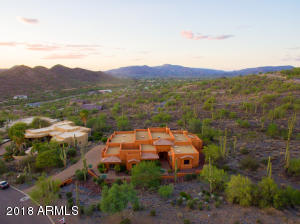 Facing northwest. Surrounded by a saguaro forest with gorgeous views. Just minutes convenient services. Feels remote, yet it's in the heart of Carefree.