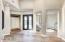 New custom wrought iron door. Open & bright foyer...