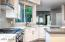 Newly updated contemporary kitchen with gas cooktop