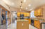Open concept kitchen with granite counters and Samsung Black Stainless Steel Appliances