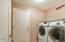 Washer and dryer convey. Access to 2 car garage with workshop