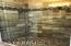 master shower porcelin wood grain tile and river rock