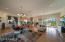 Expansive great room with multiple areas for dining and relaxing.
