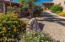 Enter the Full two room Casita from flower lined path.