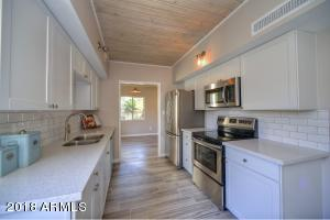 Newly Remodeled Kitchen with new stainless steel appliances and subway tile backsplash