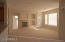 Great room floor plan with gas burning fireplace, new carpet and paint