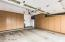 3 Car Garage features built-in Storage Cabinets!