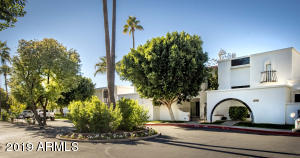 Tree-lined streets welcome you to this cozy villa in the heart of Scottsdale!