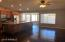 Great room - view of wood floors, eat in kitchen, breakfast bar, large kitchen island. view of fenced in pool thru the bay window of eat in kitchen.