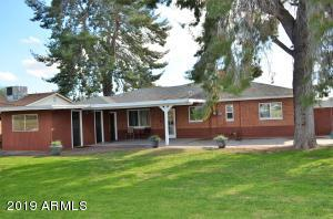 Large green back yard welcomes you. Great space for kids and pets, completely fenced.