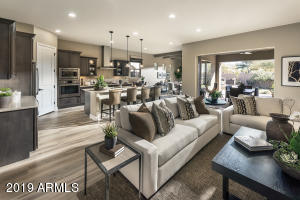 """Award-winning Great Room design provides seamless indoor/outdoor living with true """"disappearing wall of glass"""" to enjoy the premium lot backing to landscaped open space."""