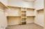 You'll be excited about this closet space with additional shelves and storage