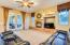 Soaring ceilings, French double doors to your exquisite backyard, Model Home drapery, surround sound speakers, gas fireplace and mantle, two tone paint, carpet