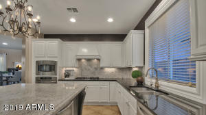 Magnolia farms modern all stainless chefs kitchen with gas cooking, granite & marble surfaces