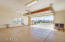 Ample room in oversized 2 car garage with epoxy floor.