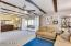 *Open Living / Dining w/ Exposed beams and sliders leading out to bonus Sun room!*