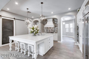 Thick quartz counters. two custom built in spice and storage cabinets, built in pantry with heavy duty pull out shelves, built in double ovens, built in microwave.