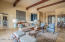 Formal living room with hand hewn beams