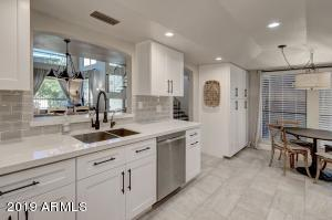 This Eat-in Kitchen will WOW you! Pull out drawers and tons of pantry space!