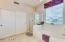 Master bath has garden tub, separate shower and HUGE closet with plenty of space for two!
