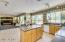 Wall of windows fills this kitchen with beautiful light!