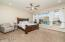 Ideal, open and spacious master bedroom split floor plan and ceiling speakers, too!