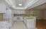 Bright kitchen with white cupboards