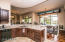 Kitchen with Breakfast Bar to Dining Room