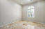 The downstairs bedroom has a walk in closet and has Travertine floors throughout.