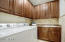 The amazing laundry room offers upgraded cabinetry an awesome deep sink.